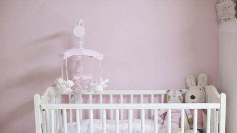 Father climbs into baby's crib