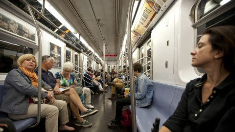 Artist falls asleep on strangers on the NYC subway and captures their reactions